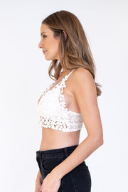 Woman wearing white daisy lace bralette with double straps