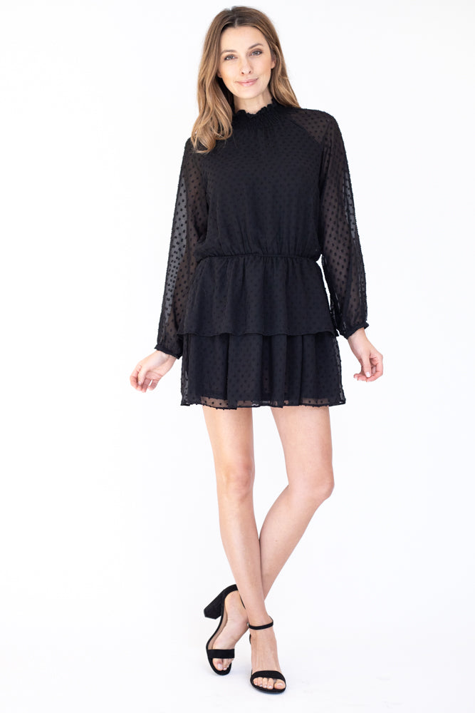 Black long sleeve dress detailed with black dots and high mock neck