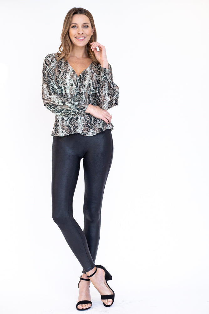 Snakeskin peplum top with a wrap v neck neckline