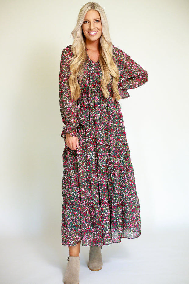 Floral patterned chiffon maxi dress with ruffled sleeves and a cinched tie waist