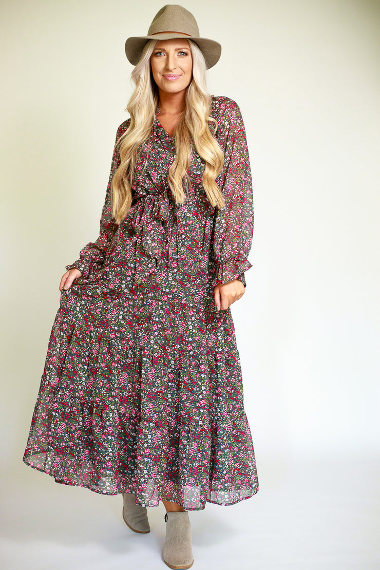 Woman wearing chiffon floral printed maxi dress with a flowy bottom