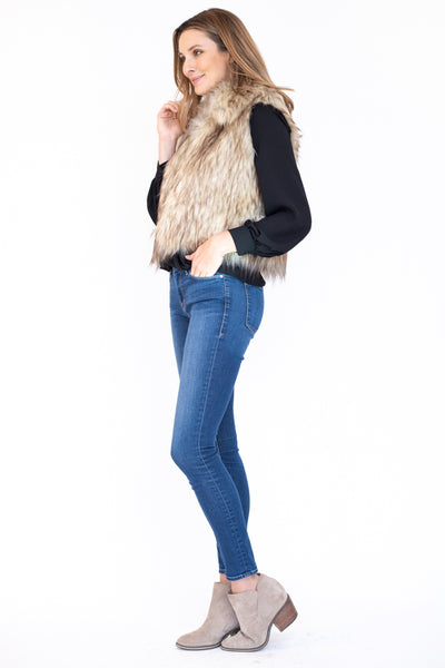 Classic faux fur vest with a shawl collar and a cropped fit