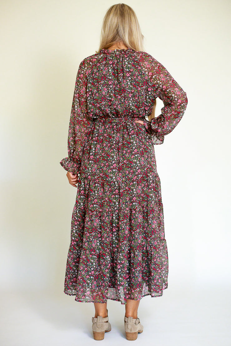 Back view of chiffon floral maxi dress with ruffled sleeves and a flowy bottom