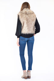 Back view of faux fur vest with a shawl collar and cropped fit