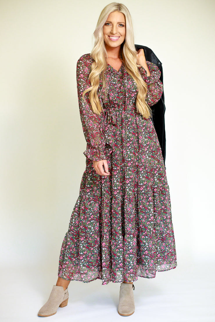 Woman wearing chiffon maxi dress in a fall inspired floral print