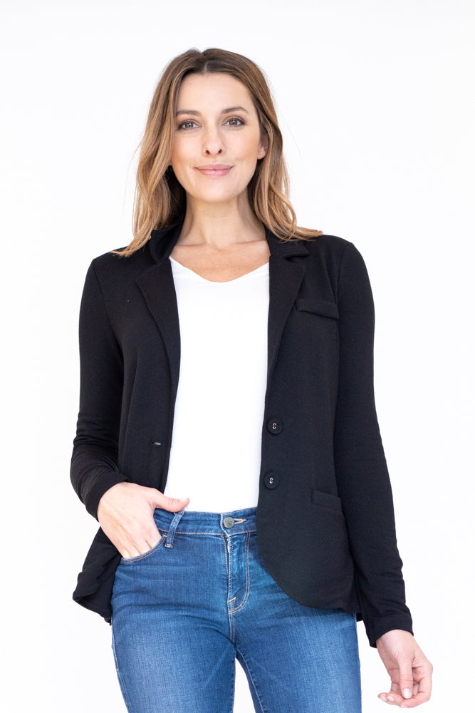 Woman wearing silky smooth classic black blazer