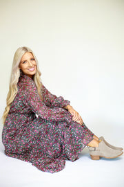 Woman sitting down in floral printed chiffon long sleeve maxi dress