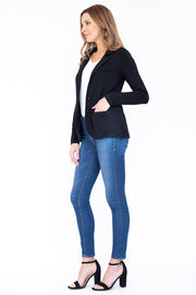 Side view of woman wearing classic black blazer