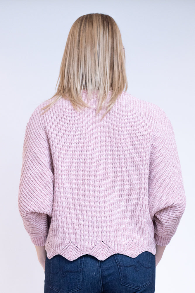 Back view of pink rose sweater with gold specks and scalloped edges