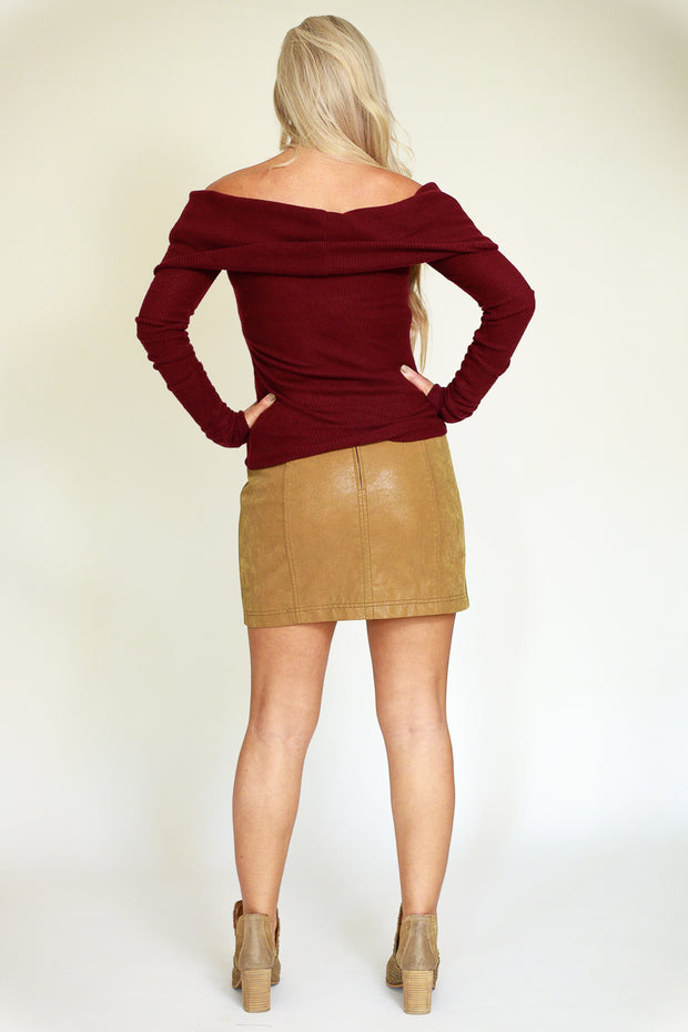 Back view of woman wearing off the shoulder bordeaux colored long sleeve ribbed top