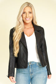 Woman wearing black vegan leather jacket with a black matte trim