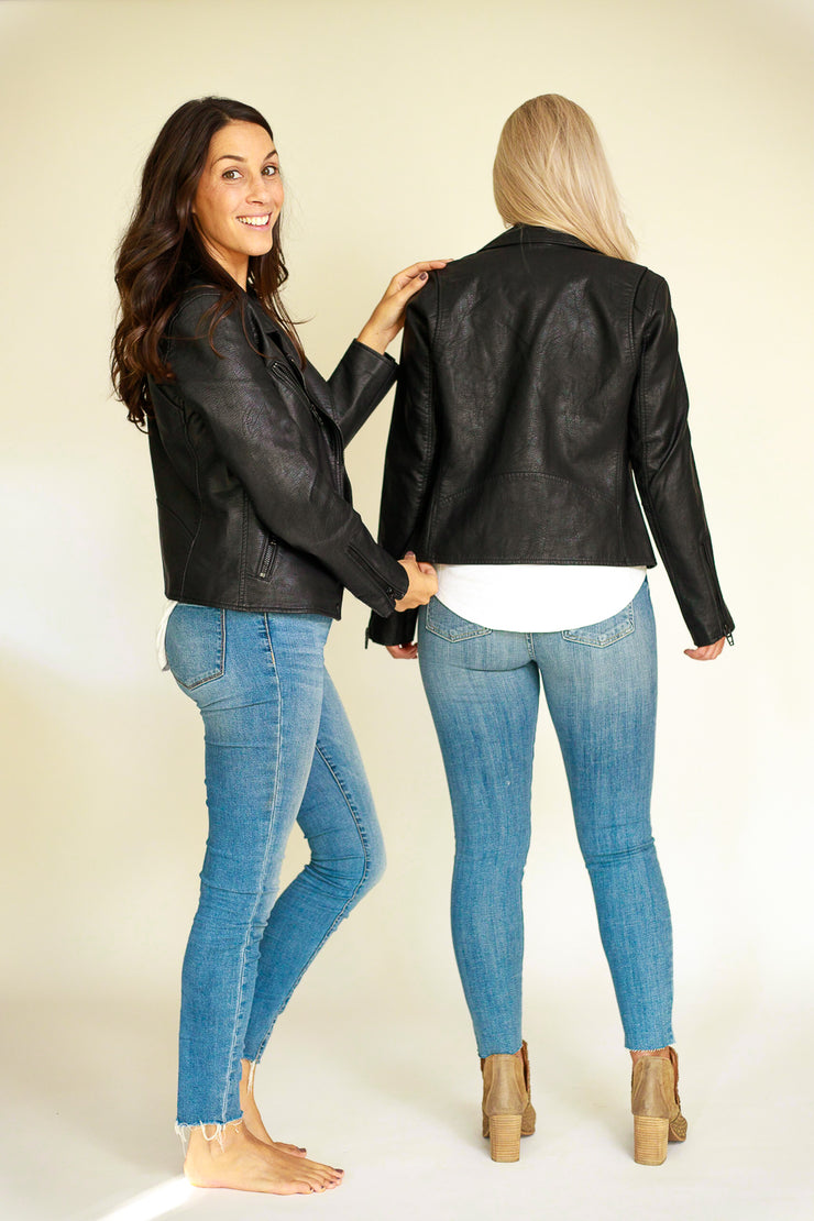 Two woman matching in the black vegan leather jacket