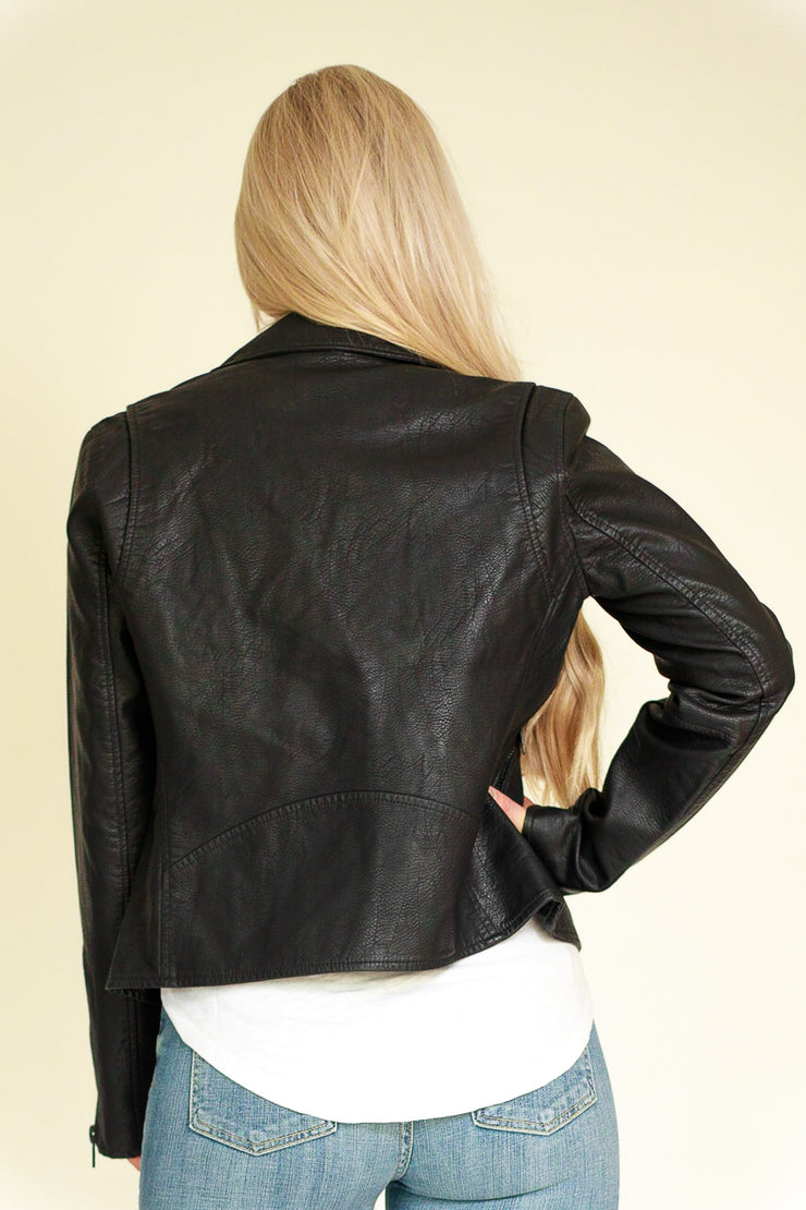Back view of woman wearing black vegan leather jacket