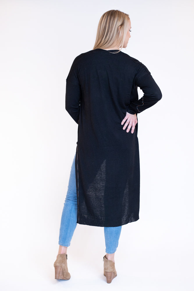 Back view of woman wearing basic black duster cardigan