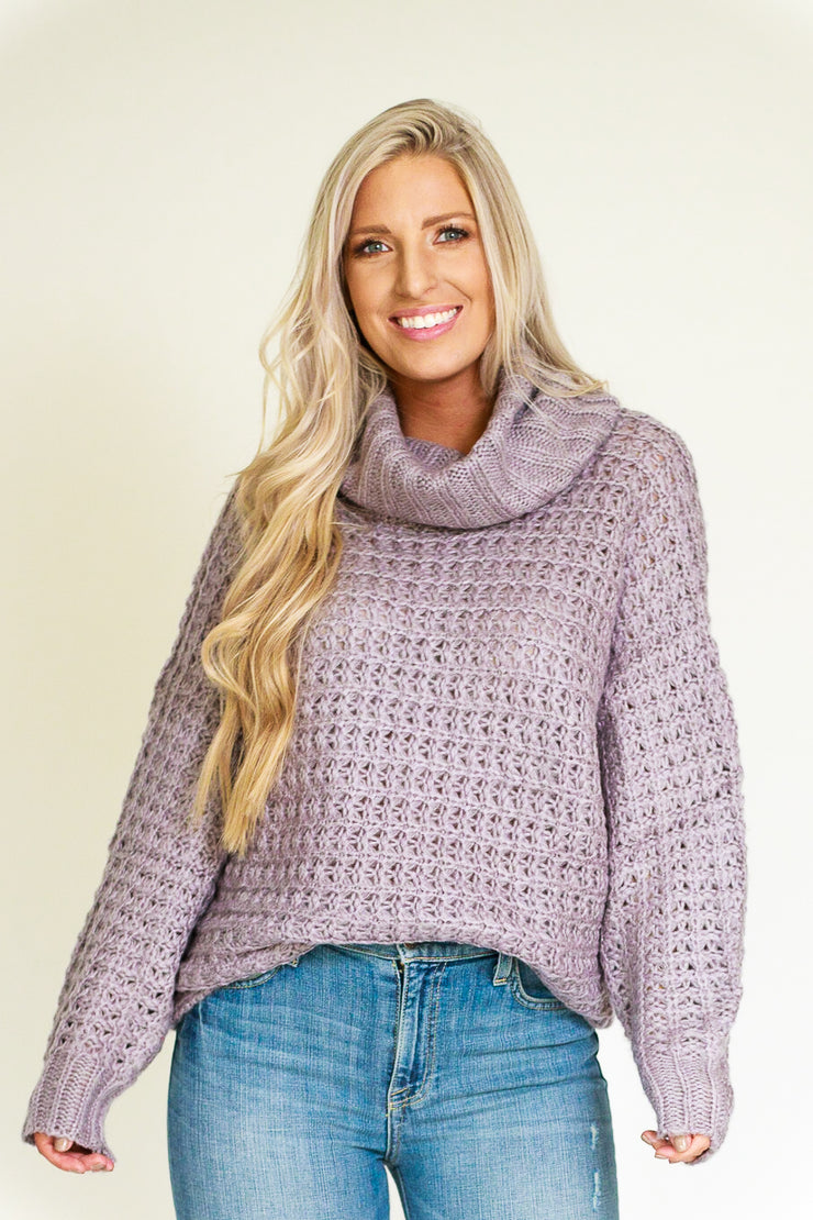 Purple/grey chunky knit sweater with a wide thick turtleneck