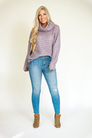 Chunky knit sweater in a grey/lilac color with a wide turtleneck