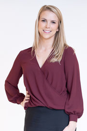 Dressy v neck top with a high low hem in pinot noir color