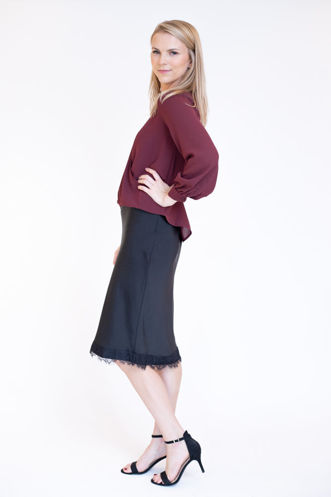 Pinot noir colored v neck long sleeve high low hem top