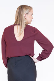 Back view of pinot noir dressy top with keyhole v detail in the back