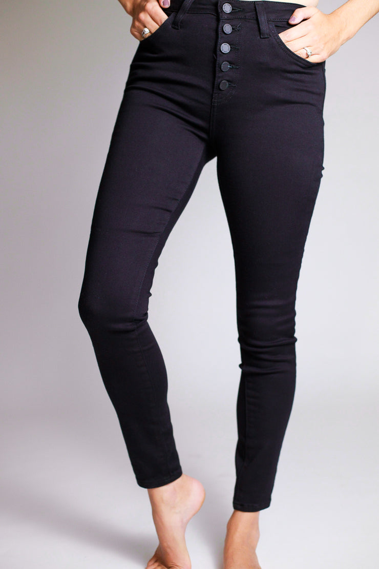 Stretchy high waisted black button down skinny jeans