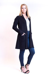 Thick longer length cardigan with pockets and a slight shawl collar