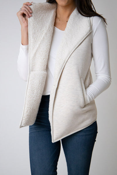 White fur lined vest with pockets