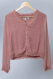 Pink with gold specks button down top that is cropped and gathers at the waist and wrists