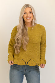 Mustard yellow knit sweater with a scalloped edge detail
