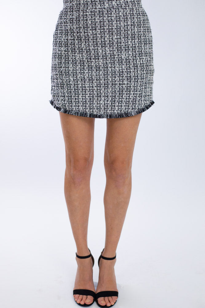 Black and white tweed tailored skirt with black and white fringe detail at the bottom