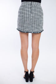 Back view of black and white tweed tailored skirt with full zip closure