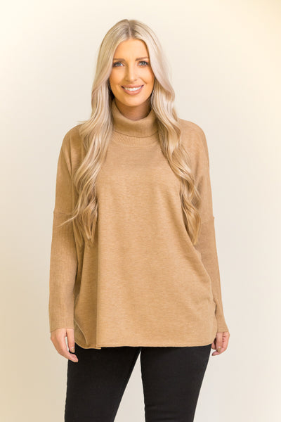 Camel colored turtle neck sweater with an open slit in the back