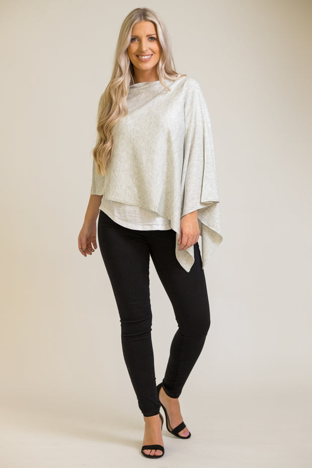 Woman wearing poncho top in light grey that can be worn 8 ways