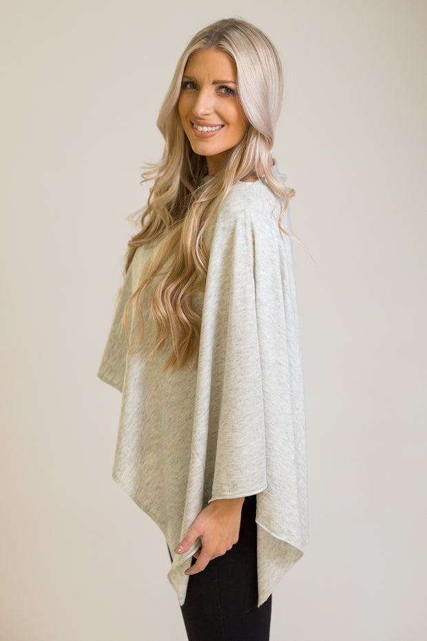 Side view of light grey poncho that can be styled 8 ways