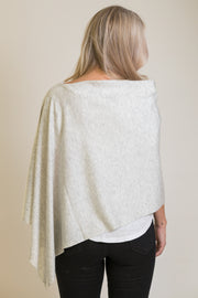 Back view of woman wearing light grey poncho