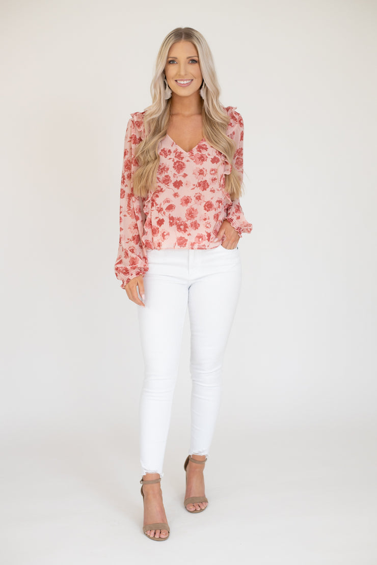 Long sleeve sheer pink floral top with ruffle details