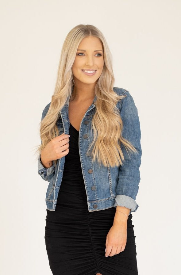 Denim jacket with buttons in a medium wash and a structured but comfortable fit