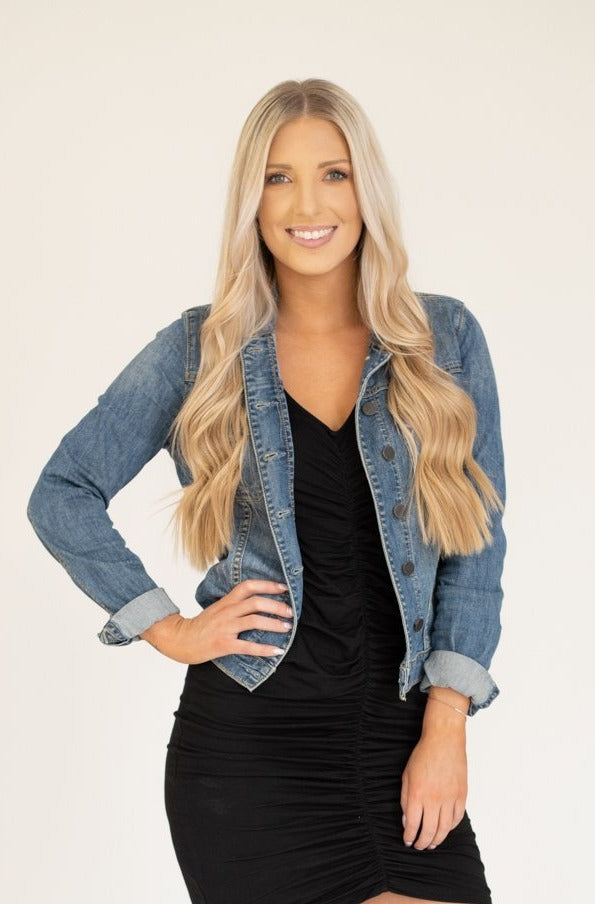 Classic denim jacket with buttons and distressed medium wash