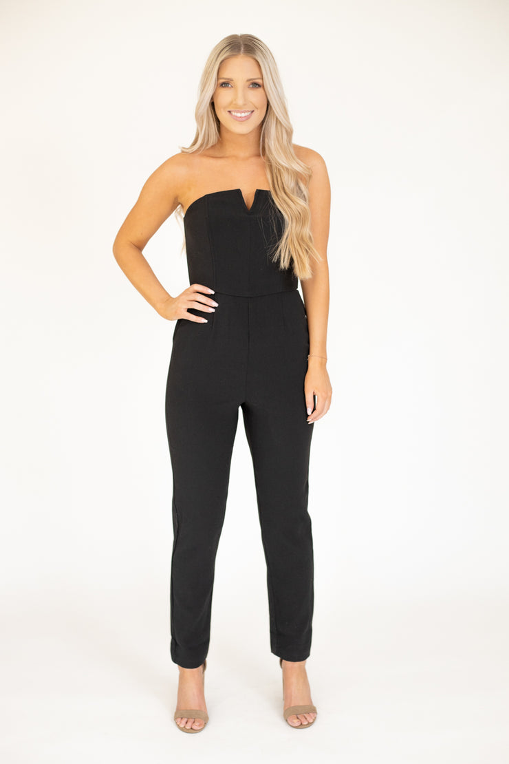 Black strapless jumpsuit with a cut out at the top and a flattering look