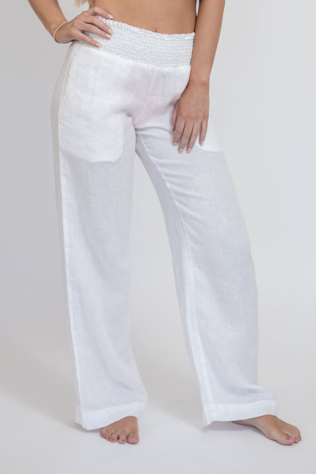 Woman wearing sheer white loose linen pants