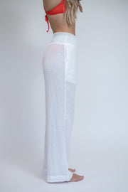 Side view of linen pants in sheet white