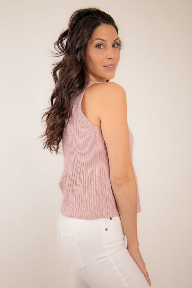 Side view of woman wearing A-line sweater tank