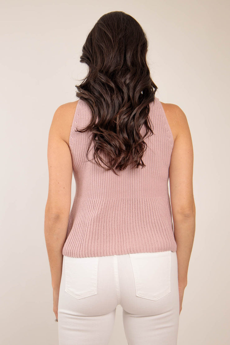 Back view of woman wearing A-line quartz pink tan colored sweater tank with thick straps