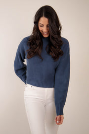 Knit mock sweater in a navy color with a slight cropped look