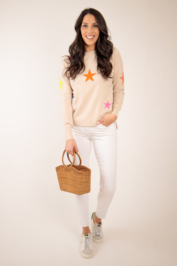 Woman in bright colored star pattern sweater
