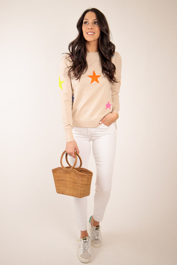 Woman standing in star pullover sweater