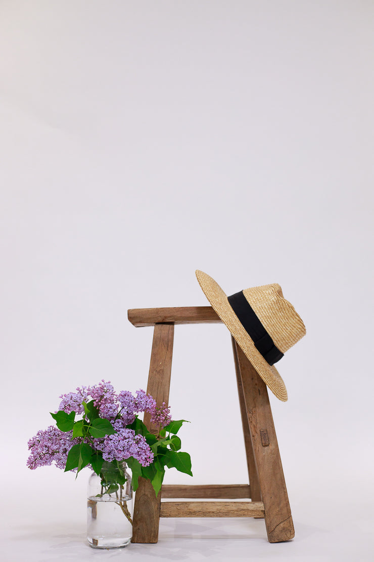 Wide brim straw had with black grosgrain strap wrapped around