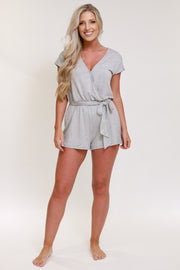 V neck short sleeve romper with tie detail in the front in a light grey color
