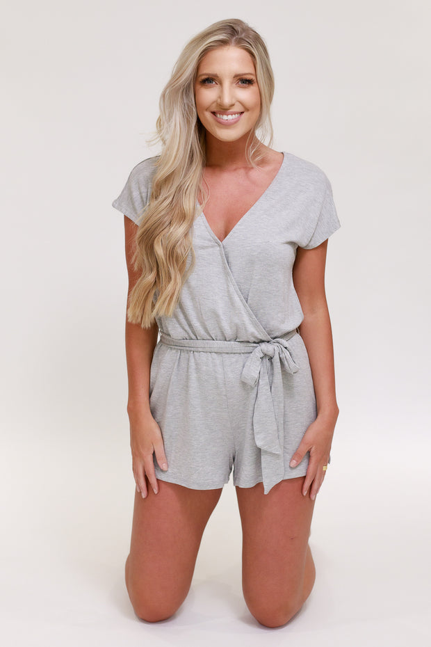 Woman in v neck short sleeve lounge romper