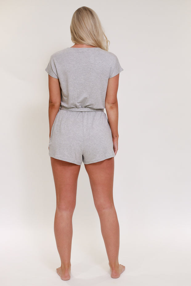 Back view of light grey lounge short sleeve romper