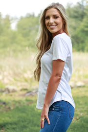 Side view of woman wearing classic white v neck t shirt